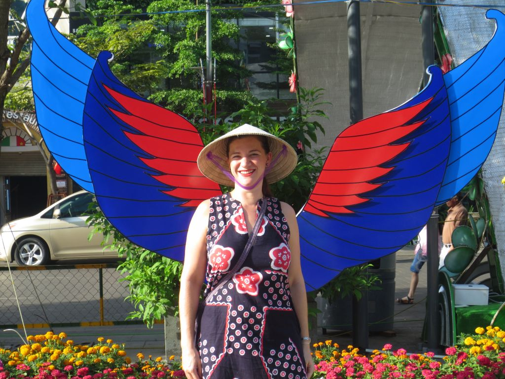 Claire Cameron with wings on Nguyen Hue Flower Street!
