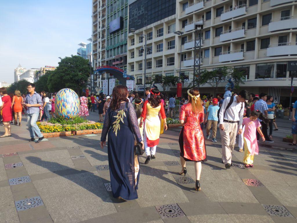Vietnamese ladies walking on Nguyen Hue