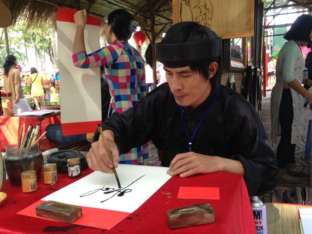 Vietnamese calligrapher in Tao Dan Park, HCMC