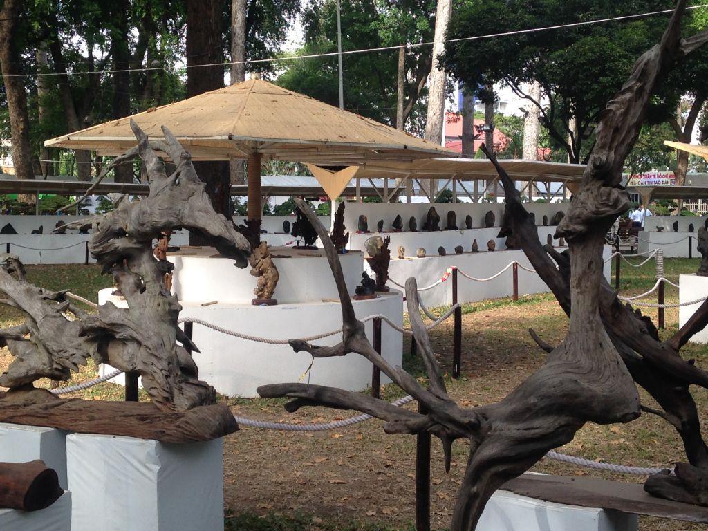 Wooden sculpture display in Tao Dan Park